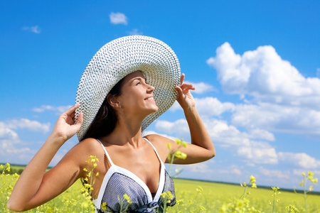 Portrait of beautiful woman standing in the middle of meadow and looking upwards with smile Stock Photo - 9726998