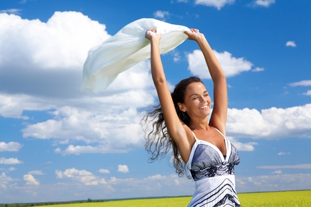 Image of happy woman holding a white fabric and laughing photo