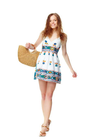 Portrait of a young girl in summer dress and with basket Stock Photo - 9726550