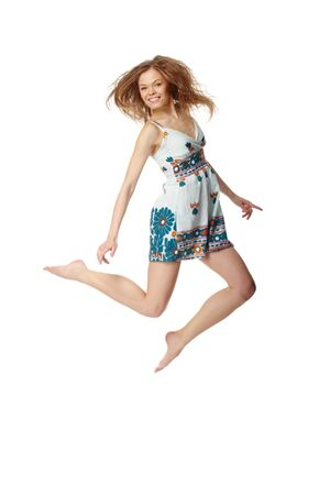 Portrait of a cheerful girl jumping  photo