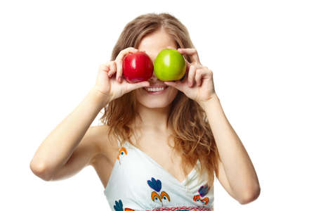 Portrait of a girl covering her eyes with apples  photo
