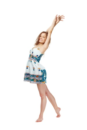 sundress: Portrait of a young girl in sundress stretching herself