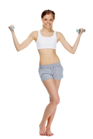 Portrait of a young girl training with dumbbells photo