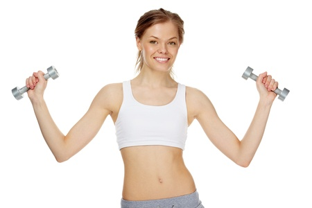 Portrait of young pretty woman holding dumbbells photo