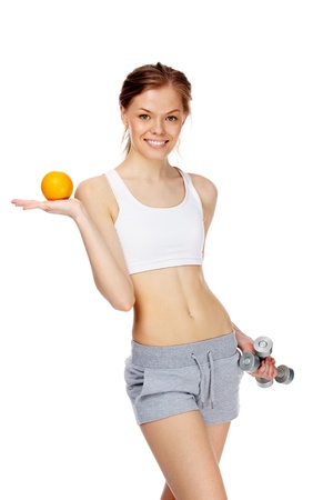 Portrait of slim young woman orange and dumbbells  photo
