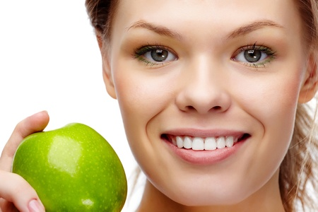 dental smile: Portrait of pretty woman with smile holding green apple  Stock Photo