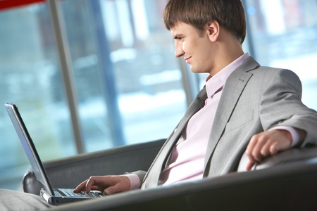 Side view of a businessman working on computer Stock Photo - 9726596