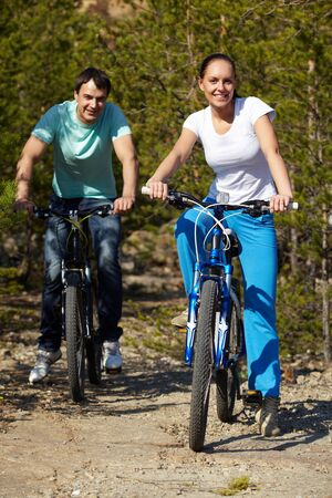 Portrait of a young couple riding bicycles  Stock Photo - 9727009