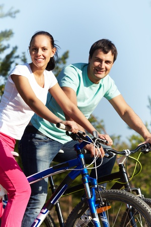 Portrait of two young people on bikes Stock Photo - 9727046