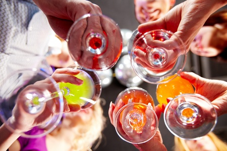 toasting wine: Below view of people clinking glasses with each other