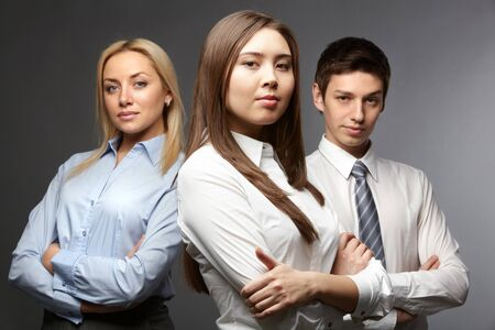 Portrait of three determined businesspeople looking at camera Stock Photo - 9726968