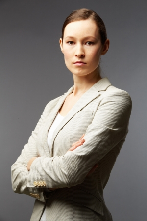 determined: Portrait of a smart businesswoman looking at camera