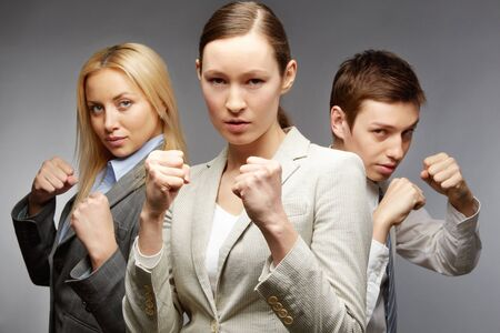 Business team of three employees standing in boxing pose  photo