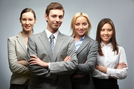 Portrait of four confident businesspeople looking at camera and smiling Stock Photo - 9726595