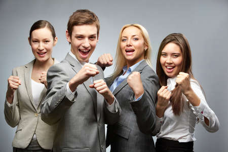 Portrait of a business team in boxing pose photo