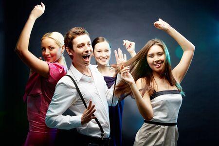 Four joyful friends dancing together Stock Photo - 9726579