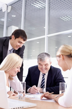 Business team of four people sitting and working together Stock Photo - 9727265