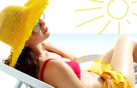 Portrait of a girl lying in the sun in chaise lounge  photo