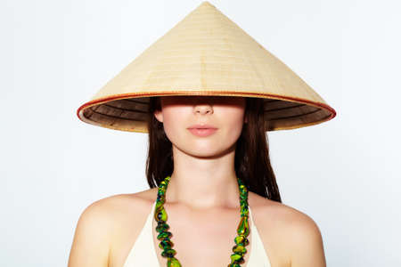 Portrait of a young girl in Vietnamese hat Stock Photo - 9727184