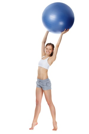 Portrait of a young girl holding gymnastic ball Stock Photo - 9727095