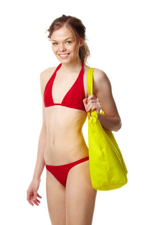 Portrait of a young girl in red bikini looking at camera and smiling Stock Photo - 9727113