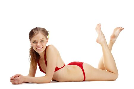 is slender: Portrait of a young happy girl in red bikini