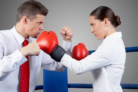struggles: Photo of aggressive business partners fighting with each other