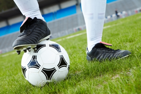 football boots: Horizontal image of soccer ball with foot of player touching it