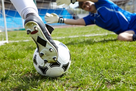 soccer goal: Horizontal image of soccer ball with foot of player kicking it Stock Photo