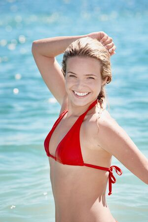 Image of happy girl standing in water photo