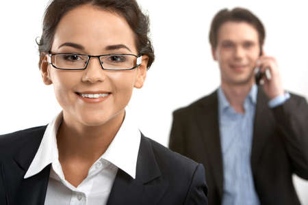 Portrait of a young businesswoman looking at camera and smiling against her colleague Stock Photo - 9727141