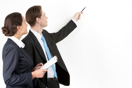 A businessman showing a plan to his colleague  photo