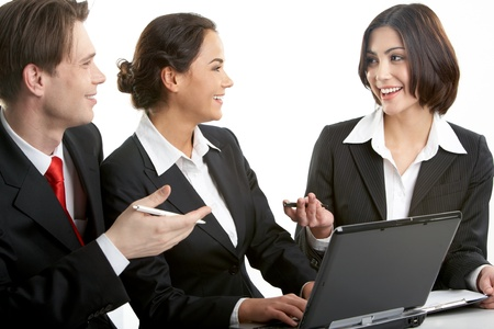 Three businesspeople sitting at table and discussing their work Stock Photo - 9727164