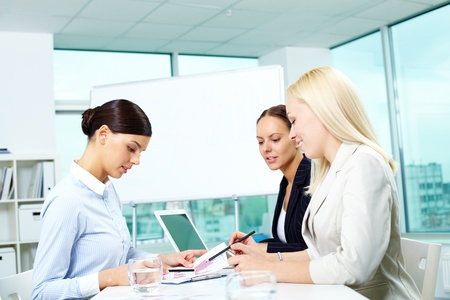 Portrait of three females working in office photo