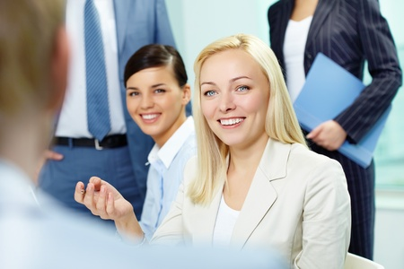 A woman manager looking at business partner during conversation Stock Photo - 9821484
