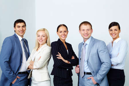A business team of five looking at camera and smiling  photo