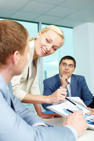 Pretty employer sharing ideas and explaining something in office photo