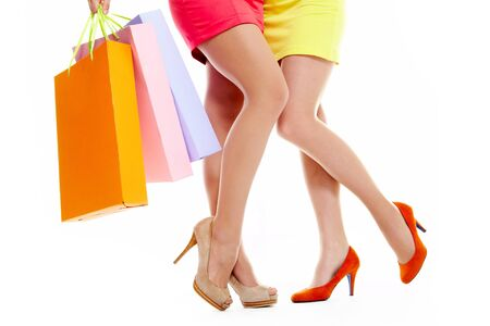 Close-up of beautiful female legs with bags over white background Stock Photo - 9804286