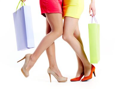 Close-up of beautiful shoppers legs over white background Stock Photo - 9804284