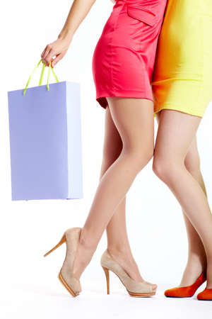 Close-up of beautiful shoppers legs over white background Stock Photo - 9804292
