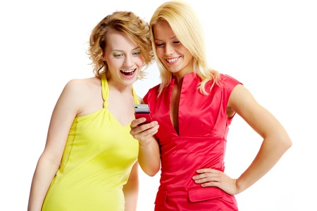 Gorgeous girlfriends reading sms on mobile phone Stock Photo - 9807488