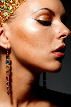 egyptian woman: Gorgeous woman with exotic accessories on black background