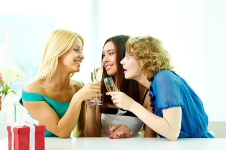 Gorgeous girls drinking alcohol on some occasion photo