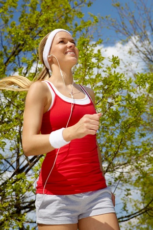 Portrait of a young woman jogging photo