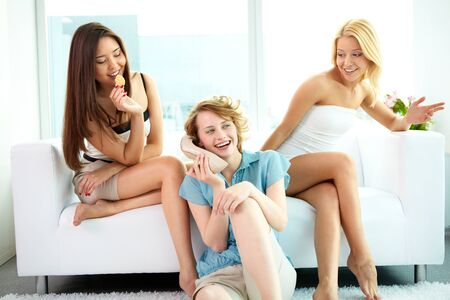 Group of pretty girls spending their time at home together photo