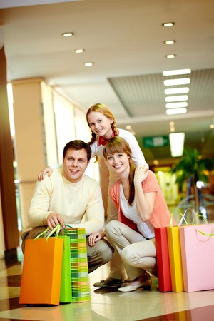 leisure centre: Image of family with paperbags looking at camera in the mall Stock Photo
