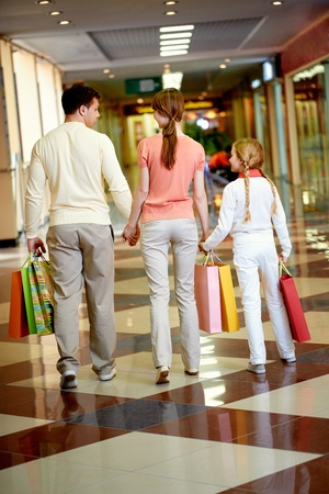 Image of family going to leave the mall after shopping photo