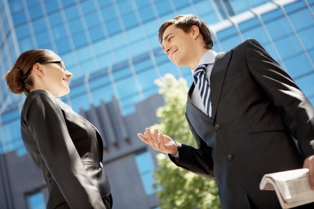 conversations: Photo of confident businessman looking at associate while communicating with her Stock Photo
