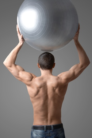 Back view of handsome man with big ball Stock Photo - 9805285