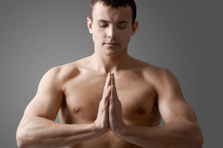 Image of handsome man with bare torso meditating Stock Photo - 9805288
